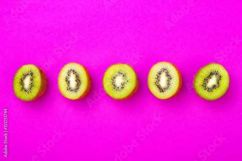 Kiwi fruit pattern on pink colored background, minimal flat lay style, copy space - 151251744