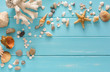 Seashells on blue wood, sea vacation background