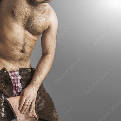 hairy man in bavarian leather pants Fototapeta