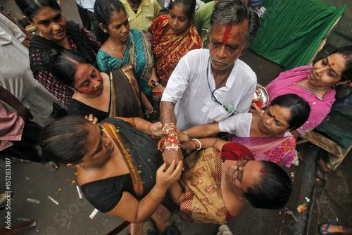 Women tie a
