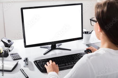 Obraz Businesswoman Working At Workplace - fototapety do salonu