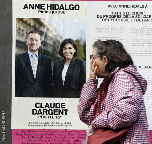 A Woman Walks Past An Electoral Panels With An Official Campaign