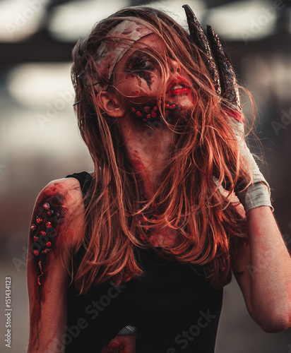Obraz na płótnie Mutant girl portrait in wounds and ulcers with nails in her head and claws instead of fingers
