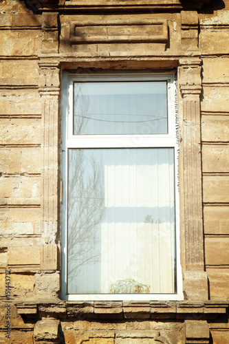 Vintage building with modern white plastic window Canvas Print