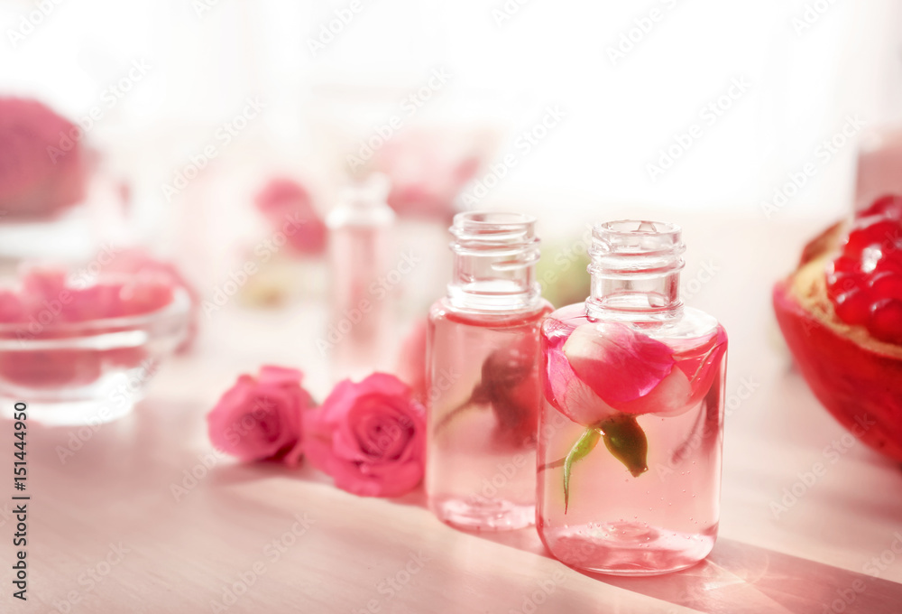 Fototapety, obrazy: Beautiful composition with perfume bottles and roses on table