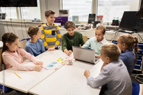 Fototapeta kids with invention kit at robotics school obraz na płótnie