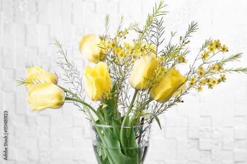 Staande foto Lelietje van dalen Vase with beautiful flowers on light background