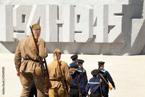 Fotografia  Group of soldiers and sailors wearing old retro USSR military uniform