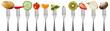 Leinwandbild Motiv Obst und Gemüse auf Gabeln, isoliert