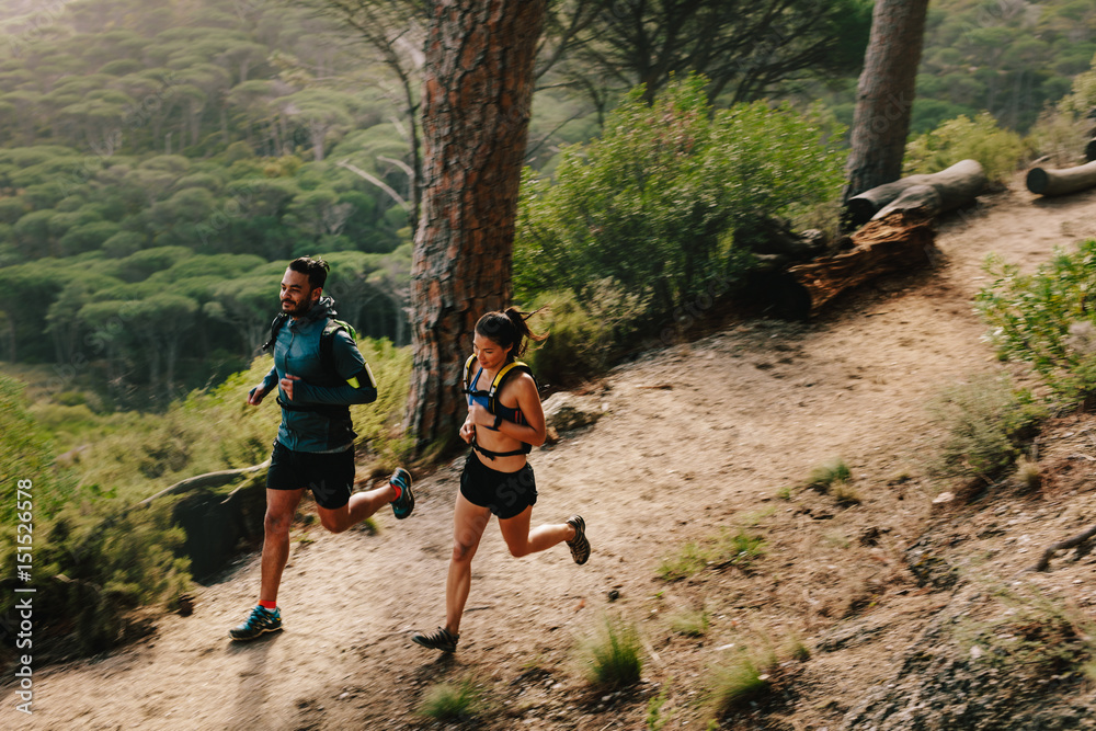 Fototapety, obrazy: Young couple doing trail running workout