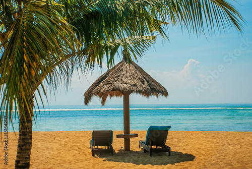 Photo  Sun loungers and parasols on the beach