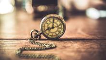 Vintage Pocket Watch On Wood Table