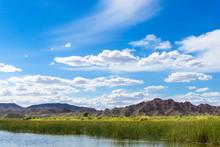 Colorado River And Mountains Under Blue Sky In Yuma Arizona