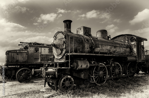 Obraz pociąg  vintage-looking-photo-of-two-rusty-old-talian-steam-and-electric-locomotives