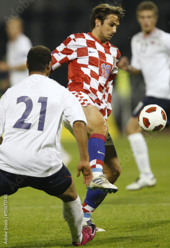 Braaten of Norway fights for the ball with Kranjcar of