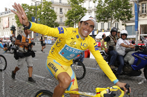 3ef9fdc9f Astana team rider and leader s yellow jersey Alberto Contador of Spain  celebrates on the Champs Elysees in Paris after winning the 97th Tour de  France ...