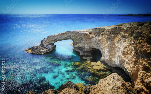 Foto op Canvas Cyprus Beautiful natural rock arch near of Ayia Napa, Cavo Greco and Protaras on Cyprus island, Mediterranean Sea. Legendary bridge lovers.