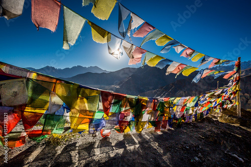Photographie Colourful Buddhist prayer flags near Lamayuru monastery in the Himalayan mountai