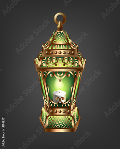 Photo  vintage gold lantern with a green glow