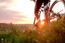 Girl Riding Bike In Sunset