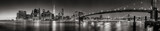 Fototapeta New York - Panoramic Black and white view of Lower Manhattan Financial District skyscrapers at twilight with the Brooklyn Bridge and East River. New York City