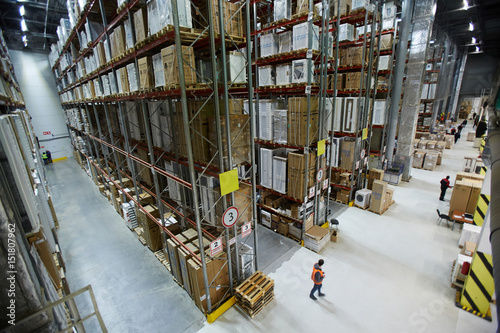 Obraz Large factory or warehouse with goods and workers - fototapety do salonu