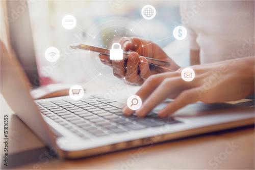 Fototapeta Woman using smartphone and laptop with icon graphic Cyber security network of co