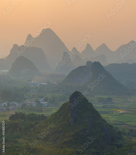 Fotobehang Guilin Foggy sunset. The view from the top of the Vine Mountains near Guilin - China