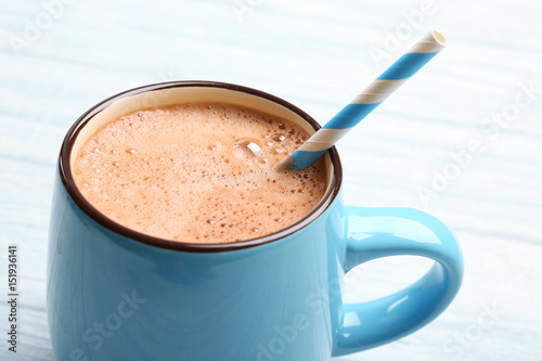 Foto auf AluDibond Schokolade Cup of tasty cocoa drink on light wooden table, closeup