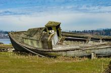 Abandones Wooden Boat On Shore