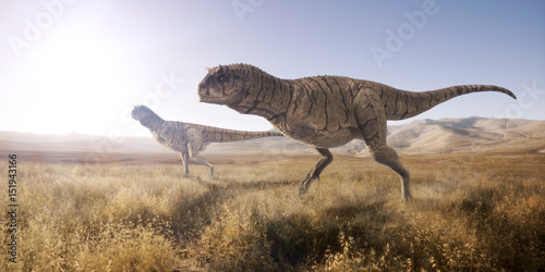 Pinturas sobre lienzo  A 3d rendering of two Carnotaurus scouting out for their next meal in open landscape