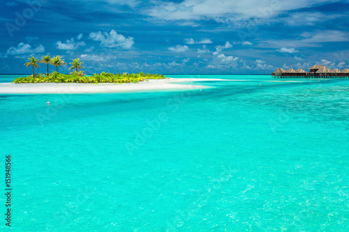 Wall Murals Green coral Tiny tropical island with palm trees in Maldives