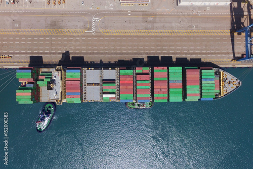 Commercial port with container ships - Top down aerial view  - Buy