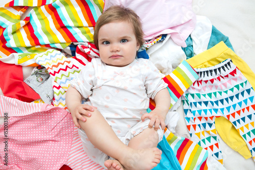Photo  Happy baby girl on background with clothing