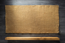 Wooden Shelf At Black Wall Bac...