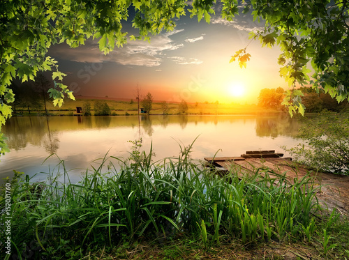 Photo sur Aluminium Orange Fishing lake in evening
