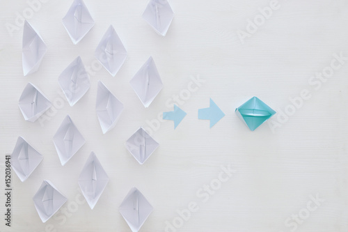 Fototapety, obrazy: paper boats and one individual boat choosing different path