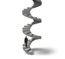 Businessman Climbing Concrete Spiral Staircase
