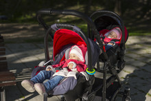 Sleeping Twins Baby In Double Stroller