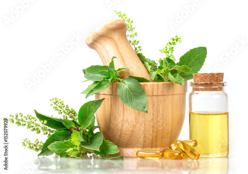 Sweet basil and hot basil in wooden mortar with essential oil and supplement, al Wallpaper Mural