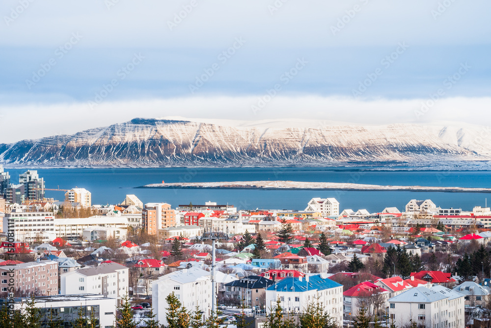 Valokuva Beautiful view of  Reykjavik winter in Iceland winter season with snow-capped mountain in the background, Reykjavík is the capital city of Iceland