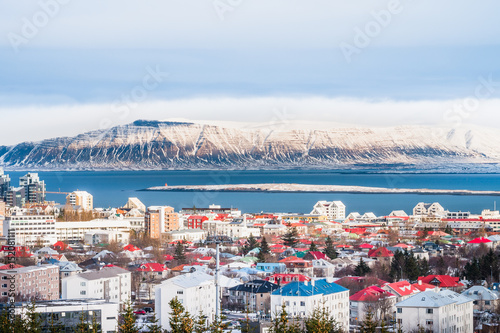 Beautiful view of  Reykjavik winter in Iceland winter season with snow-capped mountain in the background, Reykjavík is the capital city of Iceland Slika na platnu