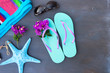 Summer beach fun - sandals with sunglasses, flowers and starfish