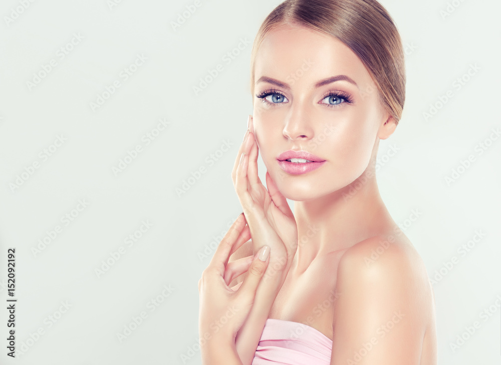 Fototapeta Beautiful Young Woman with Clean Fresh Skin . Facial  treatment   . Cosmetology , beauty  and spa .