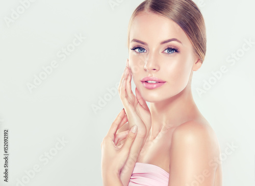 Fototapeta Beautiful Young Woman with Clean Fresh Skin