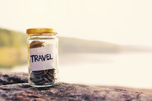 Close Up Coin On Glass Jar With Travel Word On Stone Nature Background, Color Vintage Tone