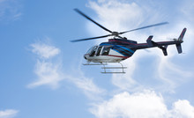 Helicopter Flying The Blue Sky