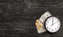 Clock With Money On Black Wood...
