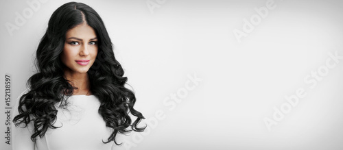 Fotografie, Obraz Beautiful brunette with long curly hair