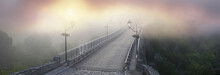 Misty Morning Bridge Over The River Below The Castle In Kamyanets-Podilsky On The Background Of The Dawn Mist Gentle Waves Give The Romantic Charm Of The Legends Of Ukrainian History..